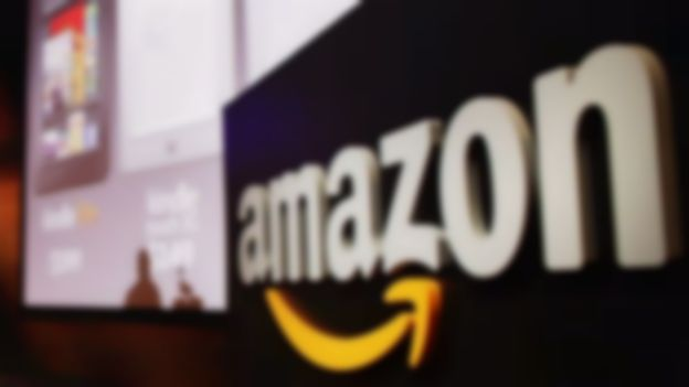 Amazon to offer free digital tracks with CD releases