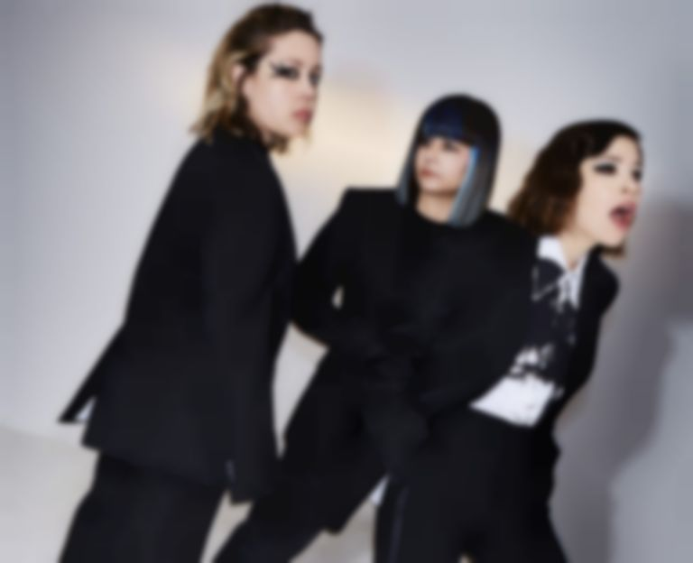"Sleater-Kinney unveil album title-track ""The Center Won't Hold"""