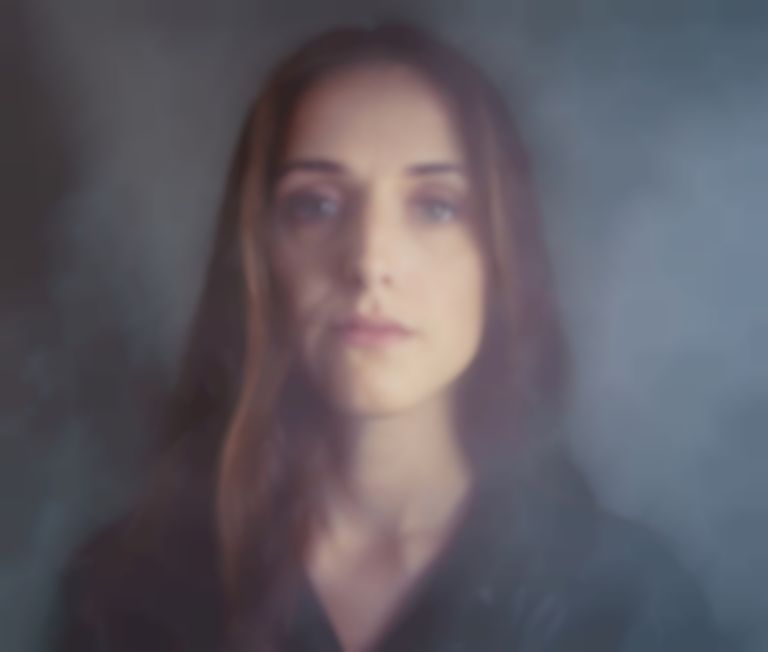 "Adna confronts the difficulties of accepting love on vulnerable new track ""November"""