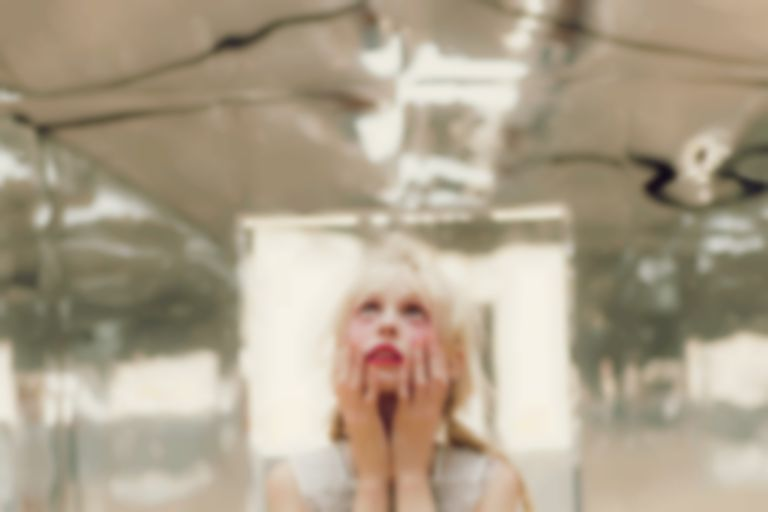 "Petite Meller ends three-year hiatus with characteristically bonkers ""Aeroplane"""