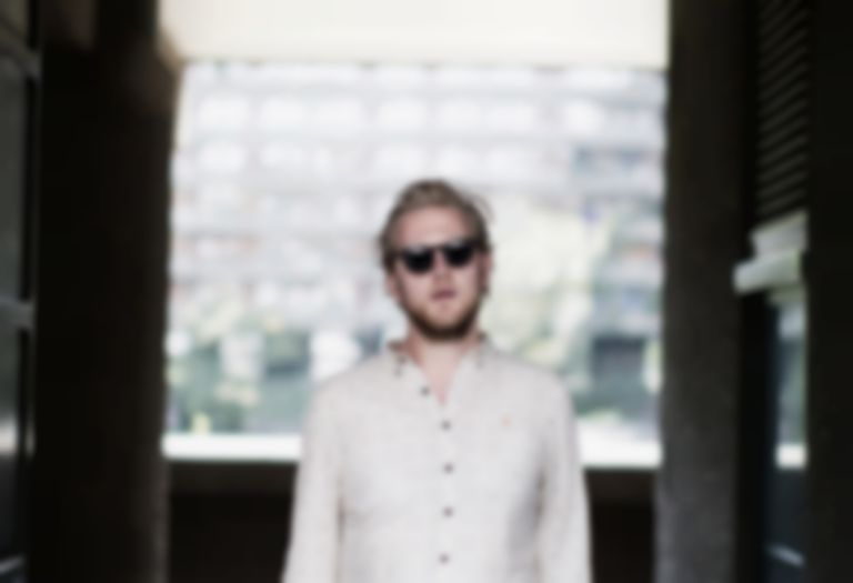 "Alexander Wolfe shares turbulent title track ""Your Love Is A Wheel"" from new EP"