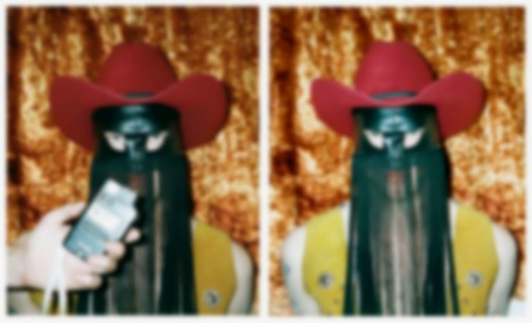 "Masked country crooner Orville Peck releases yearning Western ballad ""Dead of Night"""