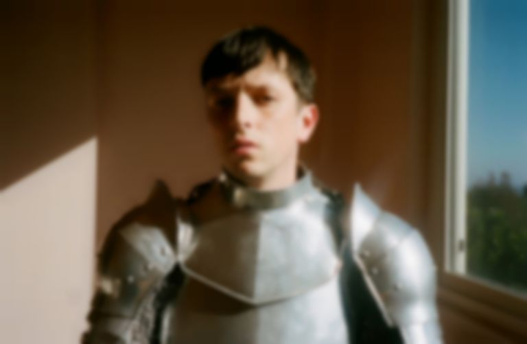 "Totally Enormous Extinct Dinosaurs makes comeback with intergalactic ballad ""Leave A Light On"""