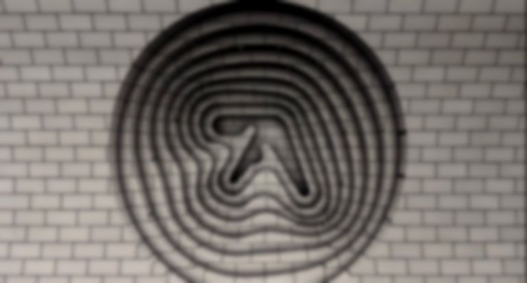 Two Aphex Twin posters have appeared in London's Elephant and Castle station