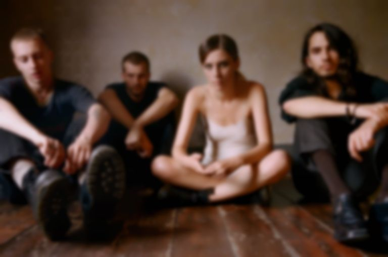 "Wolf Alice showcase a softer side on spaced-out single ""Don't Delete The Kisses"""